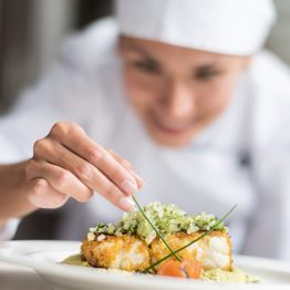 Cook decorating a plate